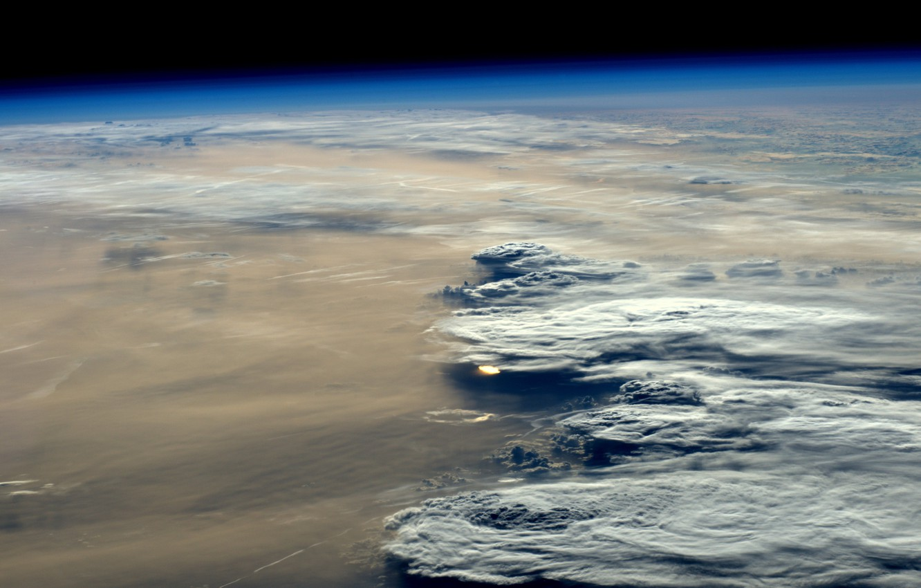 Photo wallpaper sunset, clouds, Earth from space