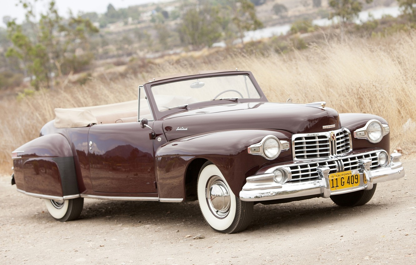 Photo wallpaper Lincoln, retro, background, Continental, convertible, the front, Burgundy, 1947, Cabriolet, Lincoln.Continental, road.grass