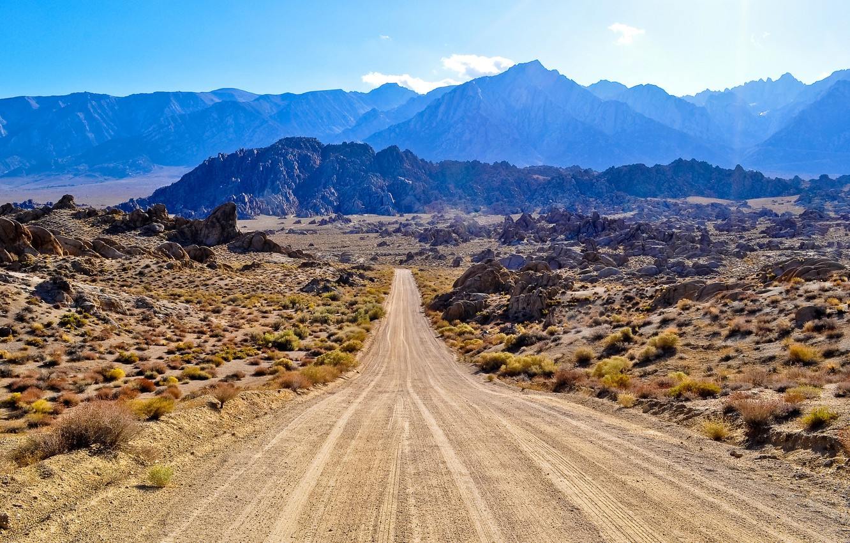 Photo wallpaper road, the sky, mountains, haze, Prairie