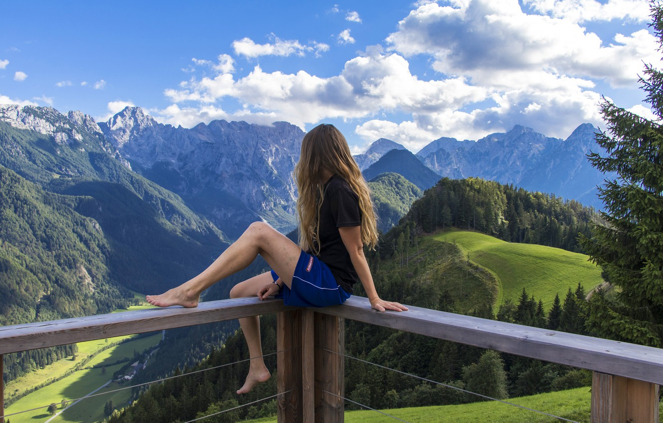 Photo wallpaper forest, summer, the sky, girl, clouds, trees, landscape, mountains, shorts, height, valley, Alps, t-shirt, brown …