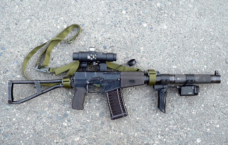 Photo wallpaper asphalt, weapons, cartridge, strap, Machine, sight, shop, arm, muffler, destruction, the handle, butt, laser, shooting, …