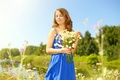 Picture summer, girl, the sun, trees, flowers, nature, river, glade, chamomile, bouquet, dress, hairstyle, brown hair, ...