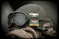 Picture glasses, helmet, a pack of cigarettes, army
