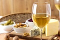 Picture wine, white, glass, cheese, nuts, olives