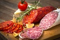 Picture tomato, sausage, cheese, cheese, sausage, rosemary, pieces, spices
